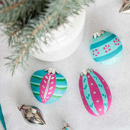Rocks with Christmas ornaments painted on them
