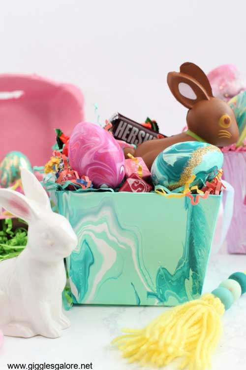 An Easter basket is decorated using acrylic paint pour for a cool look
