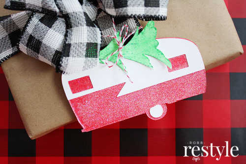 Gift tags made to look like vintage campers adorn a wrapped gift