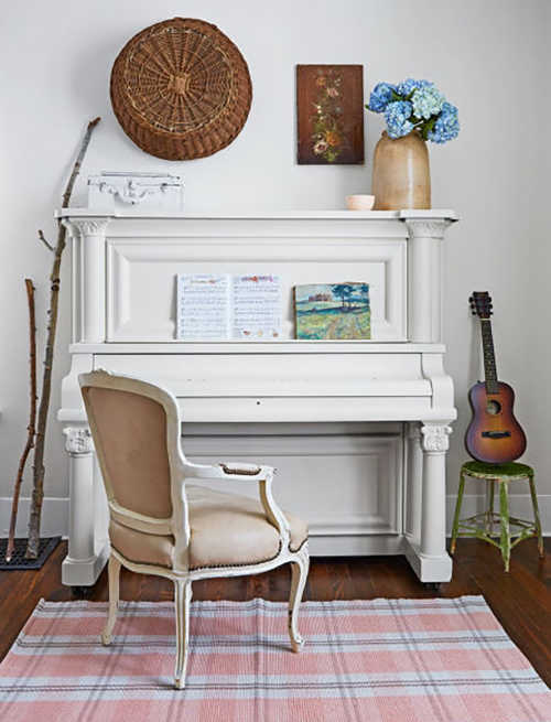 A piano painted with white chalk paint