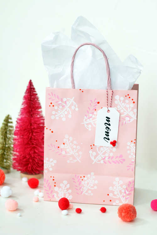 Holiday gift bags with stenciled patterns on them