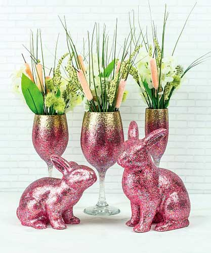 Bunny figurines are painted in pink glittery acrylic paint for a festive Easter decoration