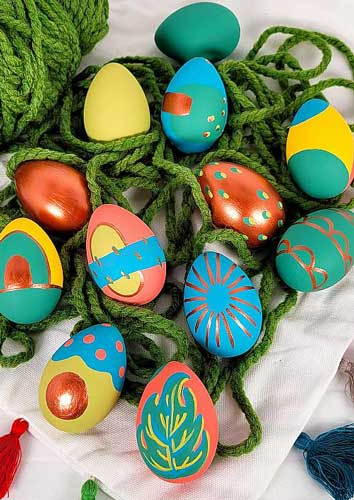 Easter eggs are painted using matte and metallic acrylic paints for a modern look