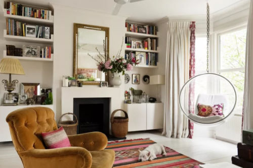 A pinkish red and white living room