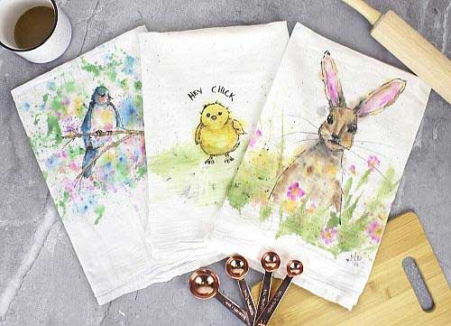 Tea towels are painted using acrylic fabric paint with several springtime designs