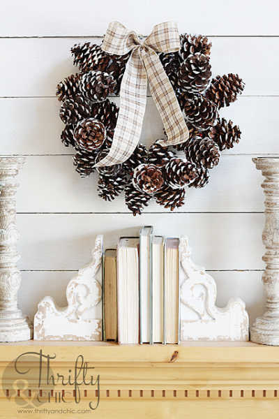 A wreath made of pinecones dipped in warm white paint