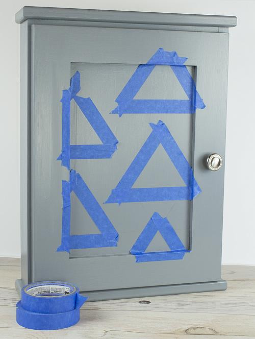 Draw The Desired Triangle Pattern Onto The Center Panel Of The Medicine  Cabinet. Tape Off Each Triangle Separately.