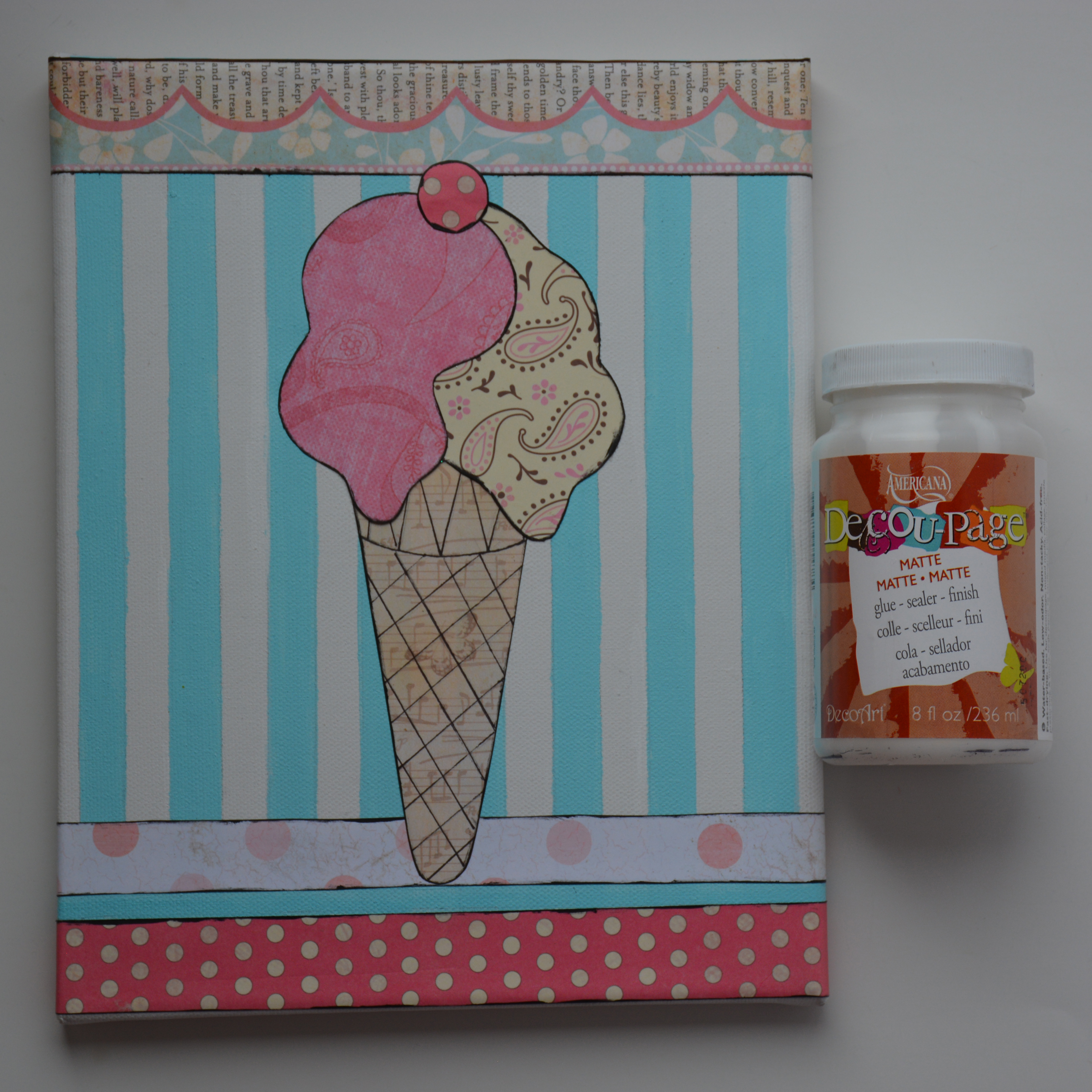 How to scrapbook canvas - Adhere The Strips Of Scrapbook Paper To The Canvas With Matte Decou Page Adhere The Ice Cream Cone Then The Vanilla Ice Cream Then The Pink Ice Cream