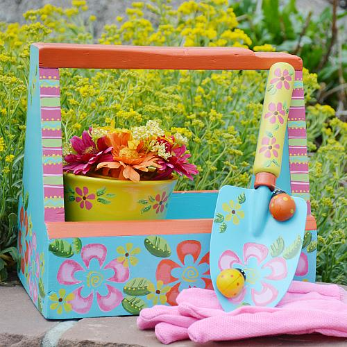 decorative garden tote with pots and garden tools