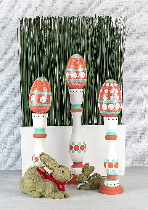 Coral and Blue Easter Eggs on Pedestals