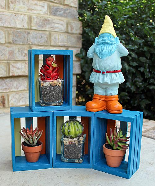 Painted Gnome and Stacked Boxes